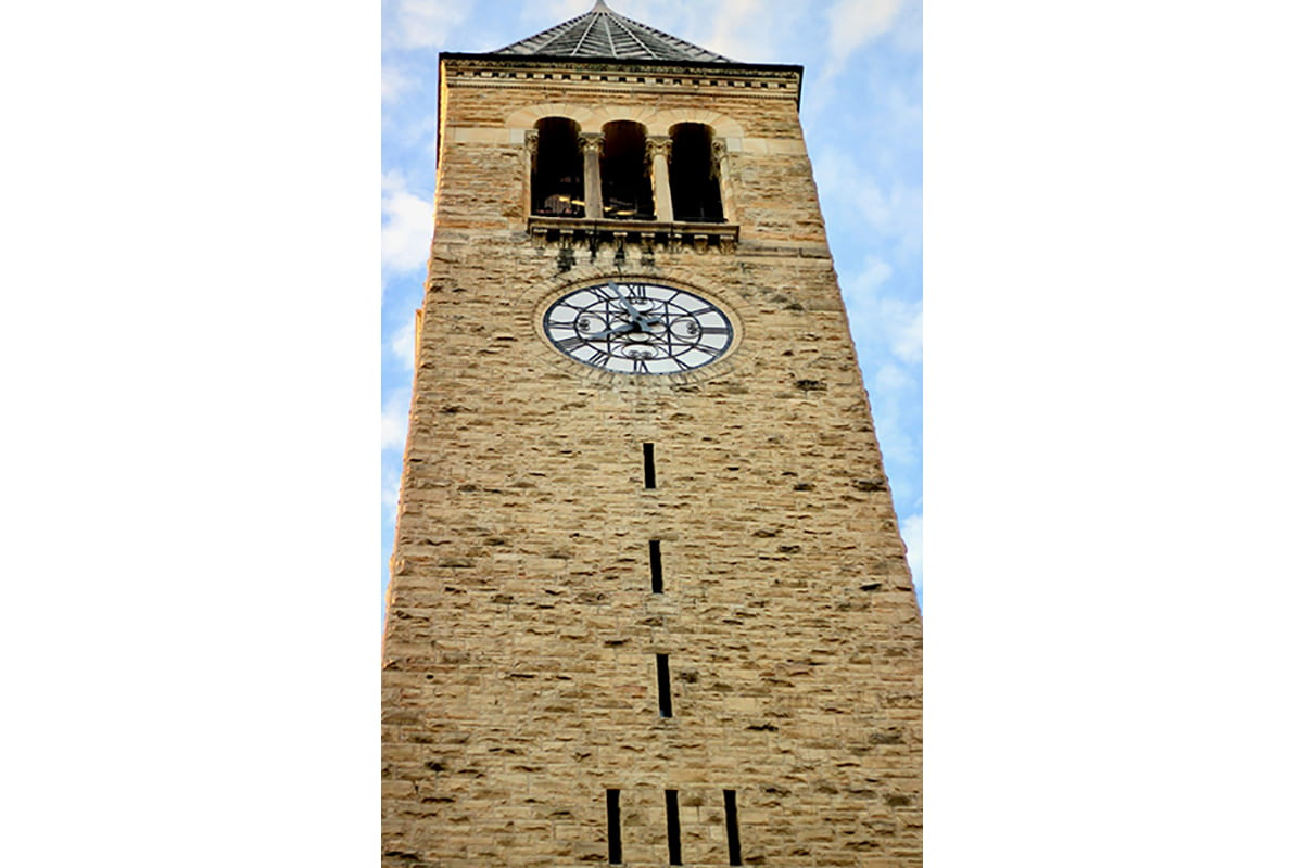A photograph of the Clock Tower looking up from the base.