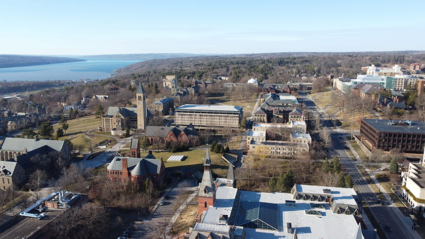 Aerial photograph of Cornell's Central Campus looking north with Cayuga Lake in the distance.
