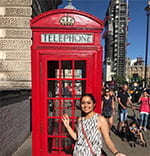 A photo of Cornell engineering student standing in front of a call box in London.