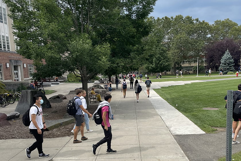 A photograph of students walking across the Engineering Quad