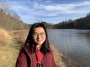 Cornell Engineering student standing by a lake