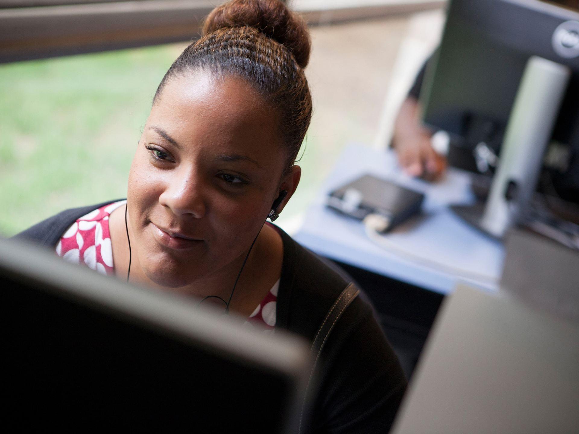 Photograph of woman at computer