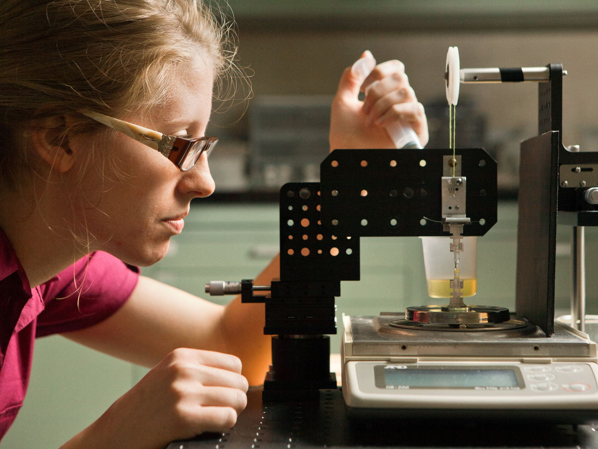 Photograph of a chemical engineering student in the lab