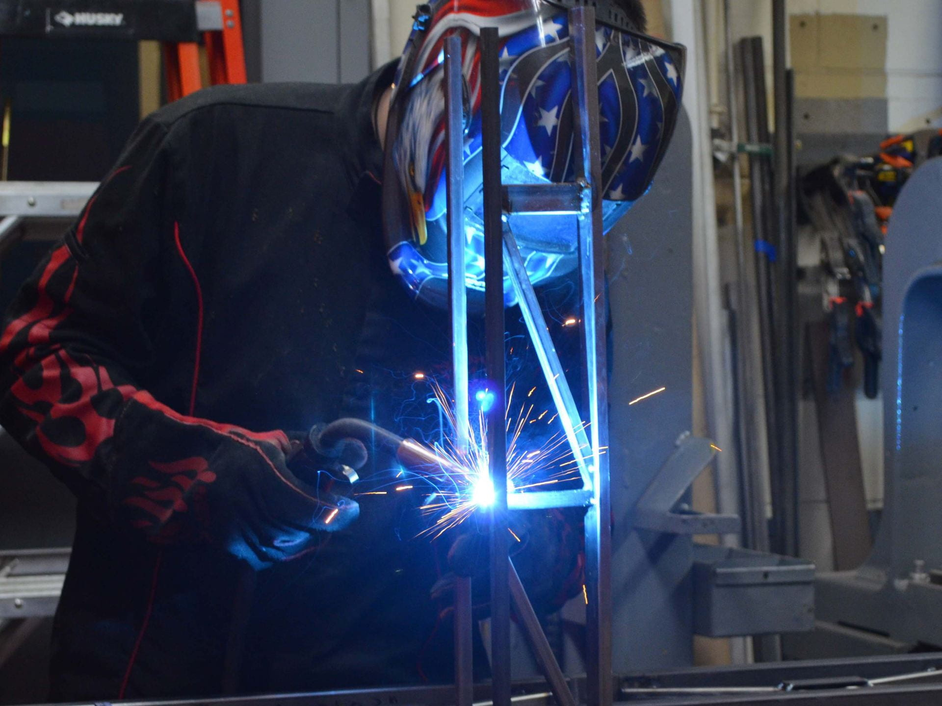 A photograph of a student welding