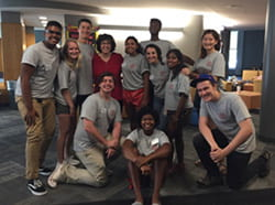 A photograph of a group of students with Cornell President Martha Pollock