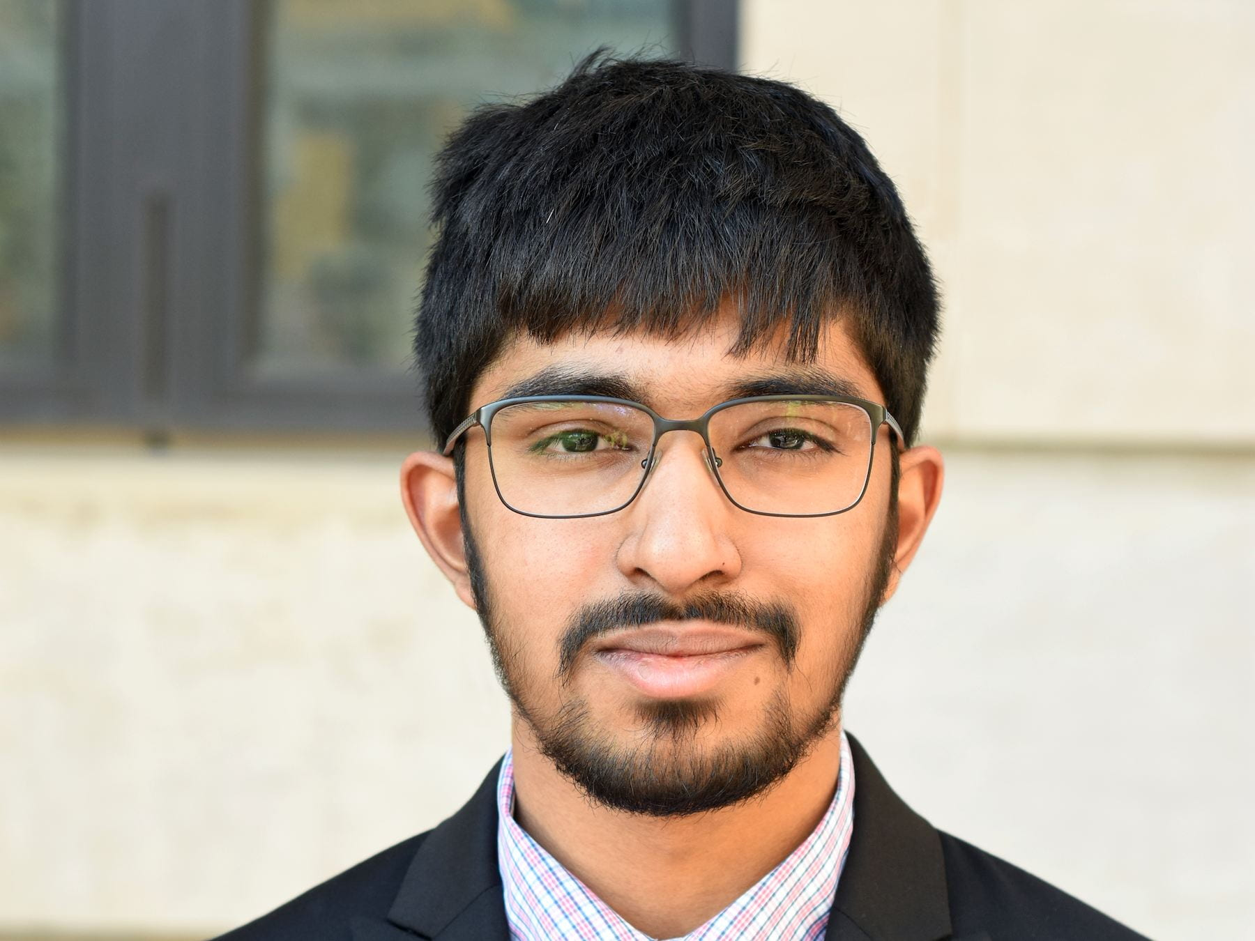 A photograph of current Cornell student Amogh