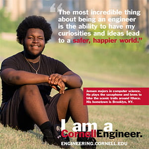 A photograph of the I am a Cornell Engineer poster with Jensen on it.