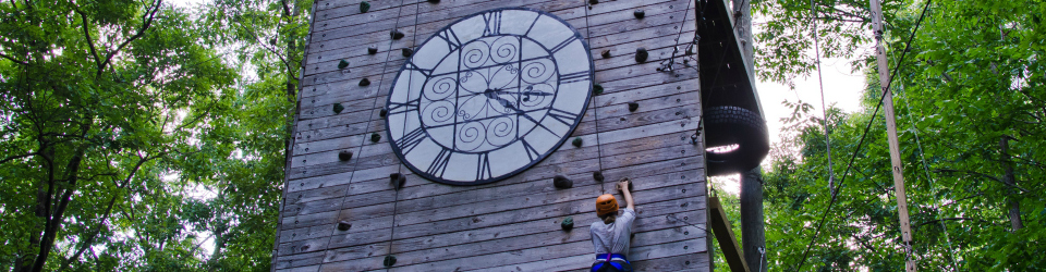 student climbs clock tower replica