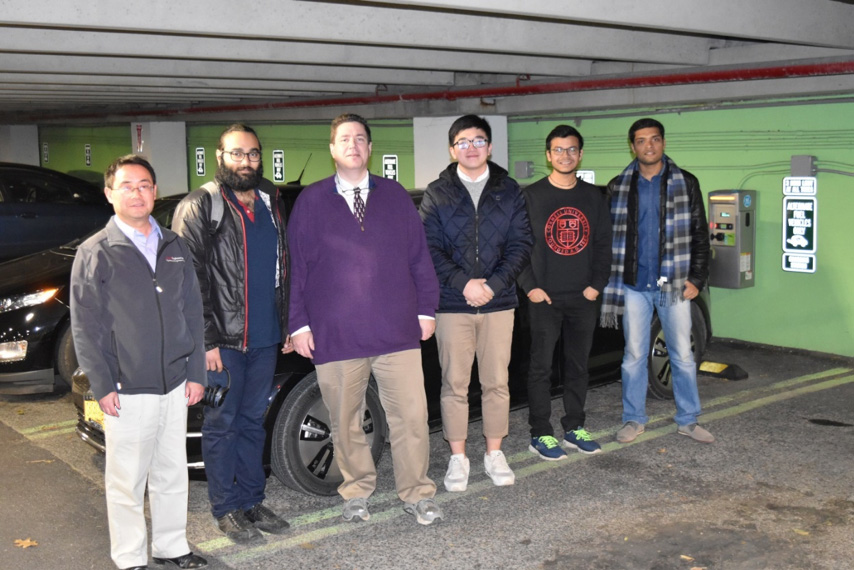 Student team visiting the EV charging facility in Hoy Road Garage at Cornell University