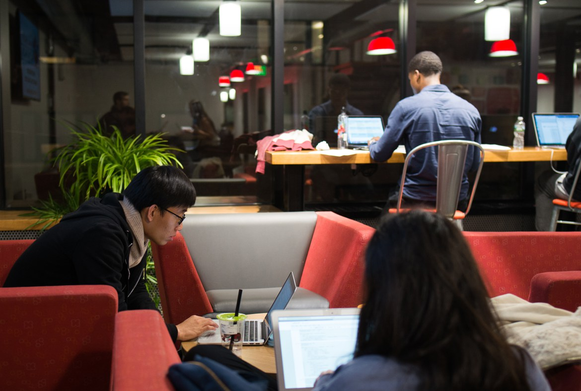 Students work late into the night at eHub. Cameron Pollack / Sun Photography Editor