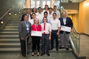 Winners of the 2018 Innovation Awards competition pose with their checks on the steps of the Duffield Atrium.