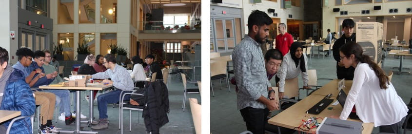 Graduate students sharing their projects with other students and visiting high school students