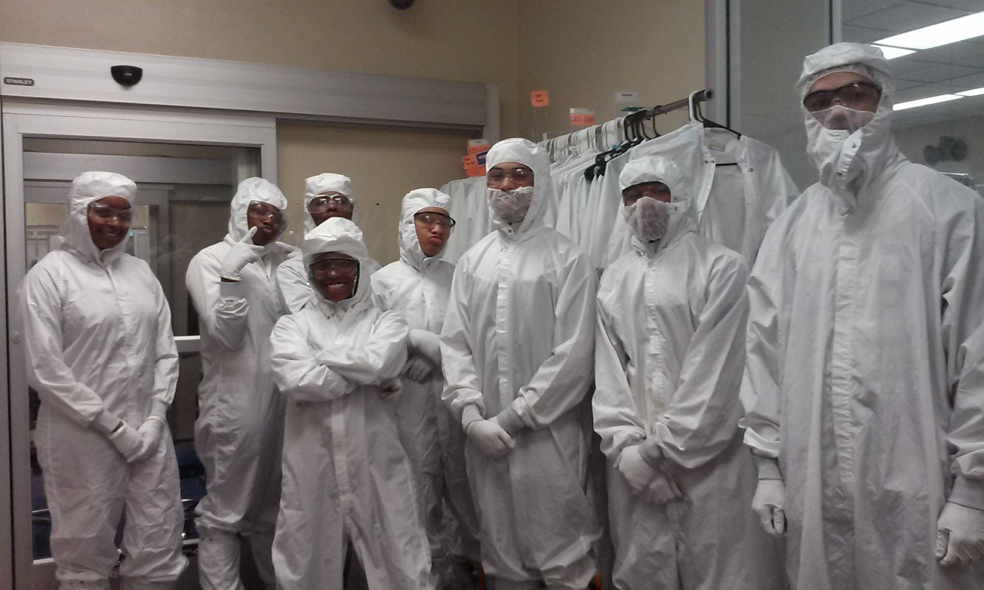 High school students in wearing cleanroom gowns