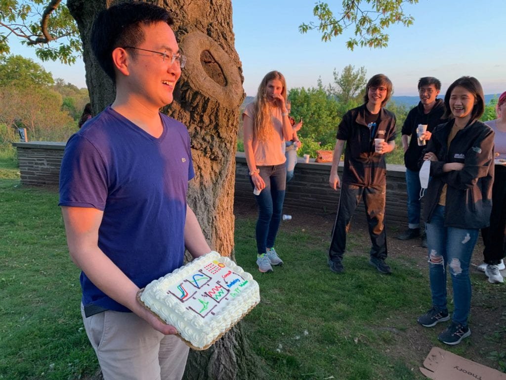 Yao holding a cake