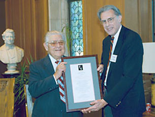 Harry Bovay, Jr. receives an award