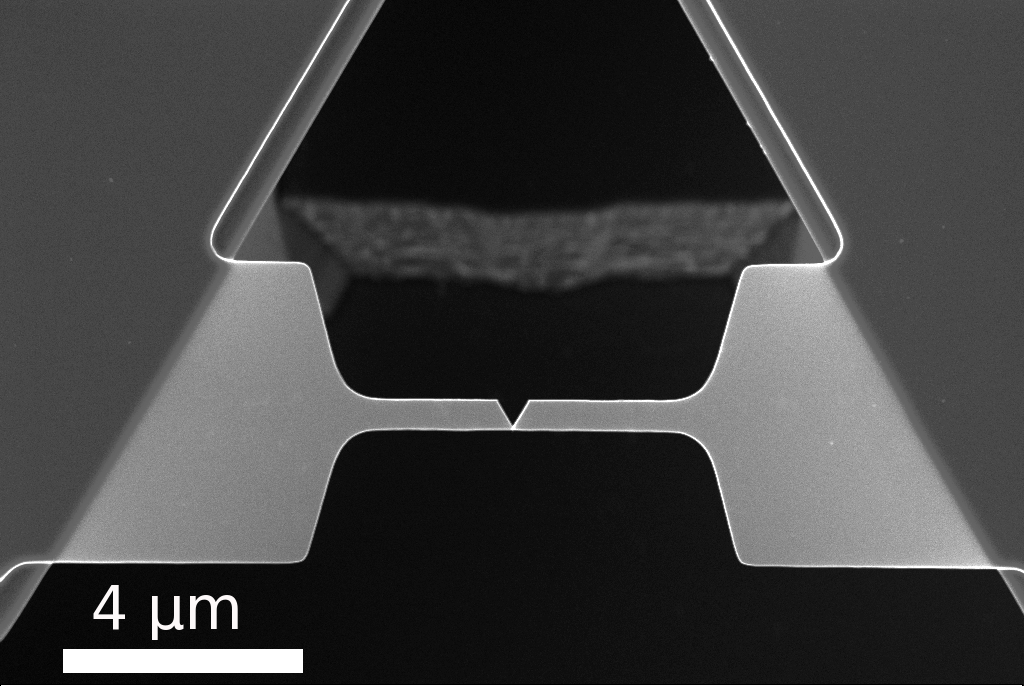 Scanning electron micro- graph of a fractured nanobeam. The V shaped notch is not part of the fabricated design but a characteristic of the failure mode.