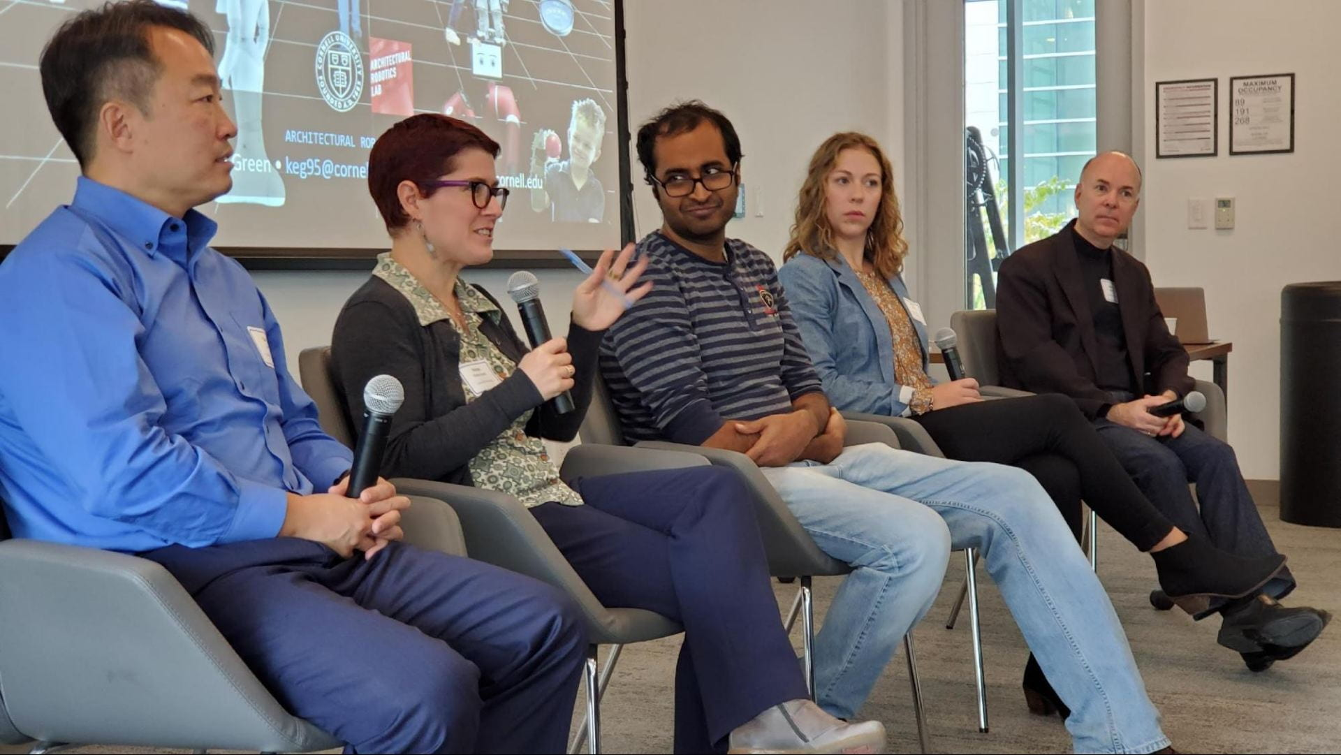 "Speakers in Session I ""Embracing the Messy World: Robotics at Cornell"", formed a panel to address audience questions about Robotics research at Cornell. From left to right, Prof. Dan Lee, Prof. Hadas Kress-Gazit, Prof. Bharath Hariharan, PhD student Maura O'Neill (representing Prof. Rob Shepherd's Organic Robotics Lab), and Prof. Keith Green."