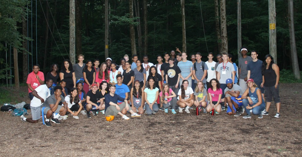 Group cohort photo with woods in the background
