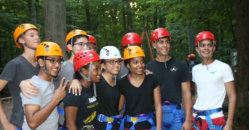 Group of participants in safety helmets at Hoffman Challenge ropes course