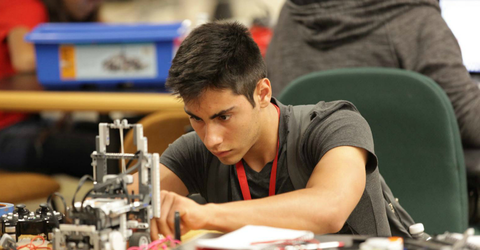 Male participant adjusts his LEGO Mindstorm robot