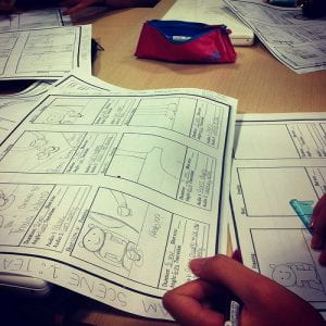 A person drawing out a storyboard