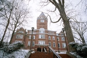 Photograph of Tech Tower in the winter. Snow covers the shrubs along the sides of the brick steps leading up to the building.