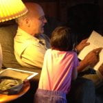 Tracy's dad reading to granddaughter