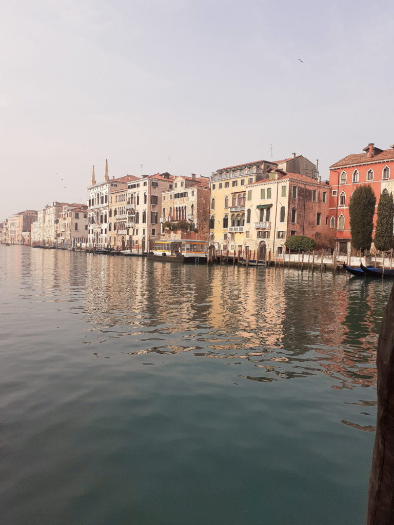 The Grand Canal on a sunny day, as seen from a vaporetto station.