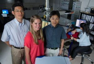 Georgia Tech has created a mechnical device for potential stroke rehabilitation. Pictured (l-r): Professor Jun Ueda, Lauren Lacey, and Associate Professor Minoru Shinohara