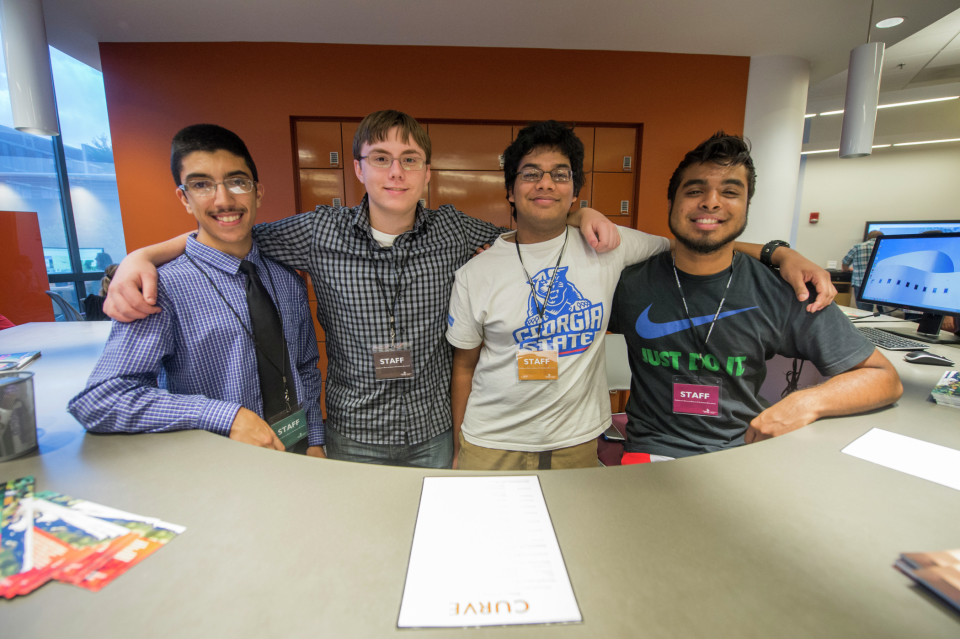CURVE Honors students and SIF Fellows, Charbel Aoun, Caleb Lloyd, Wasfi Momen, and Shakib Ahmed  assist with the event.