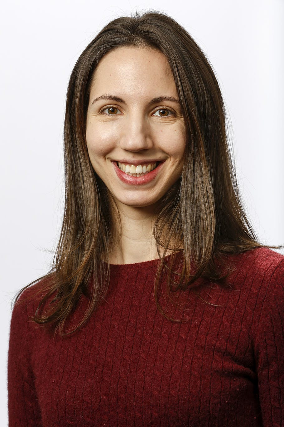 Portrait of Abby Tadenev against a white background.