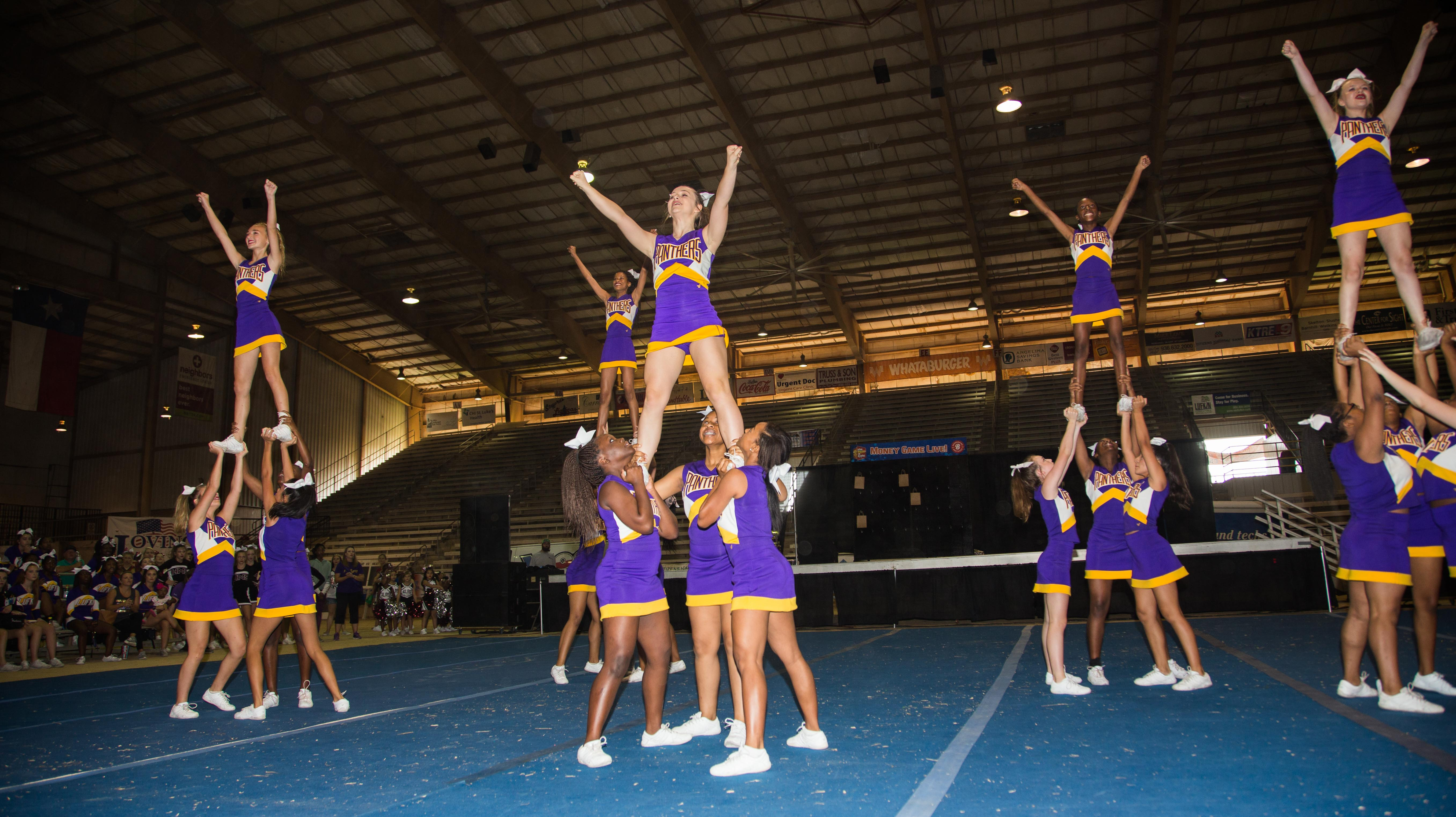 Contact US >> Photos of Lufkin ISD cheerleaders performing at the Texas State Forest Festival | Lufkin ISD