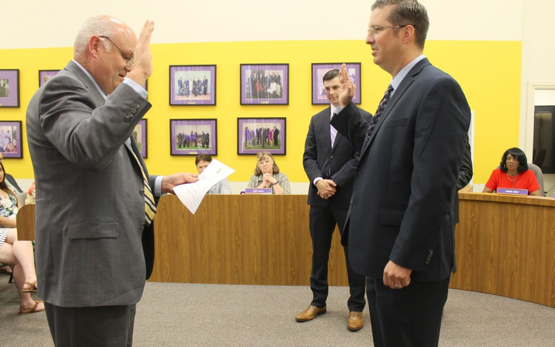 New board member, Matt Knight, sworn into office