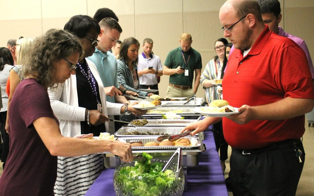 Admin and Board welcome new teachers at luncheon