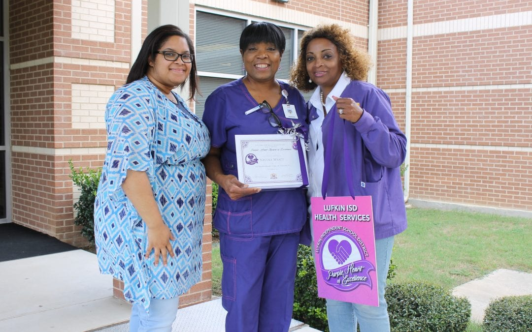Purple Heart of Excellence Award given to Necole Wyatt