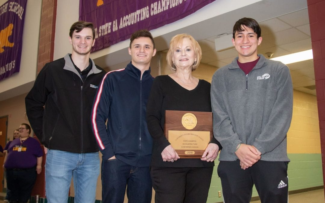 State accounting team recognized with flag on LHS Main Street hallway