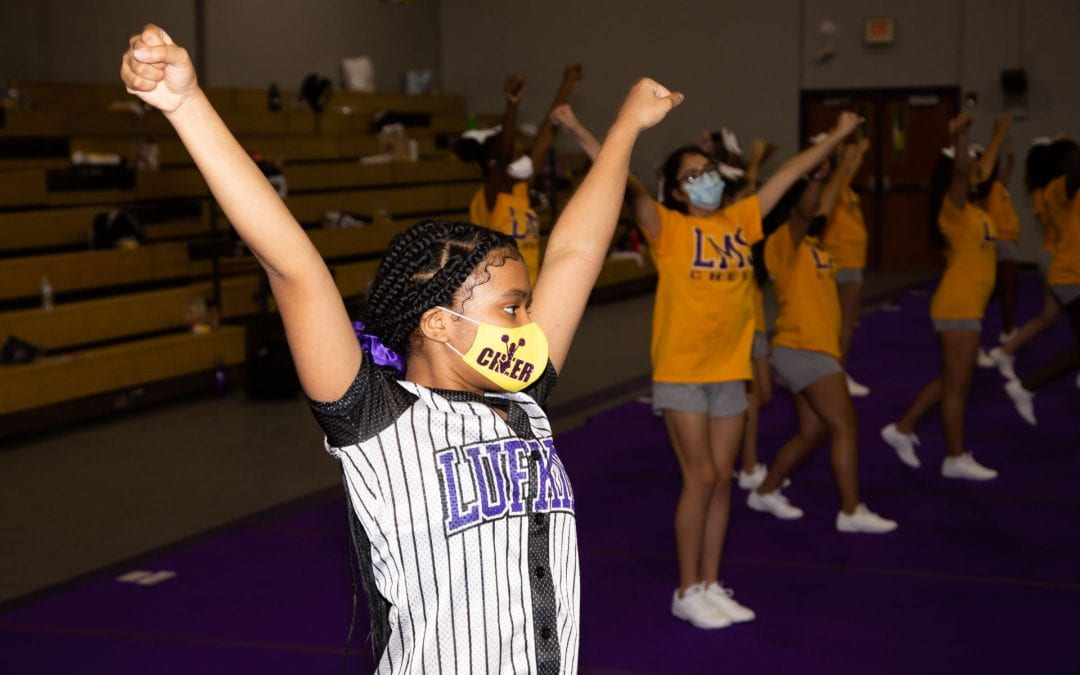 """LHS cheerleaders participate in NCA """"home"""" cheer camp"""