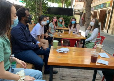 Students and staff meeting at a local coffee shop