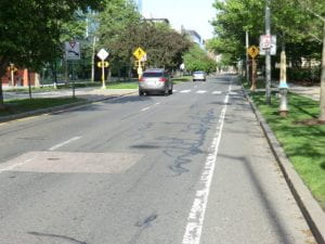LTS 2: Bike lane not next to parking, 2+2 lanes with raised median, 30 mph