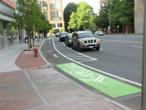 LTS 1: Protected bike lane.
