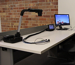 Classroom teacher's station with document camera and touch panel