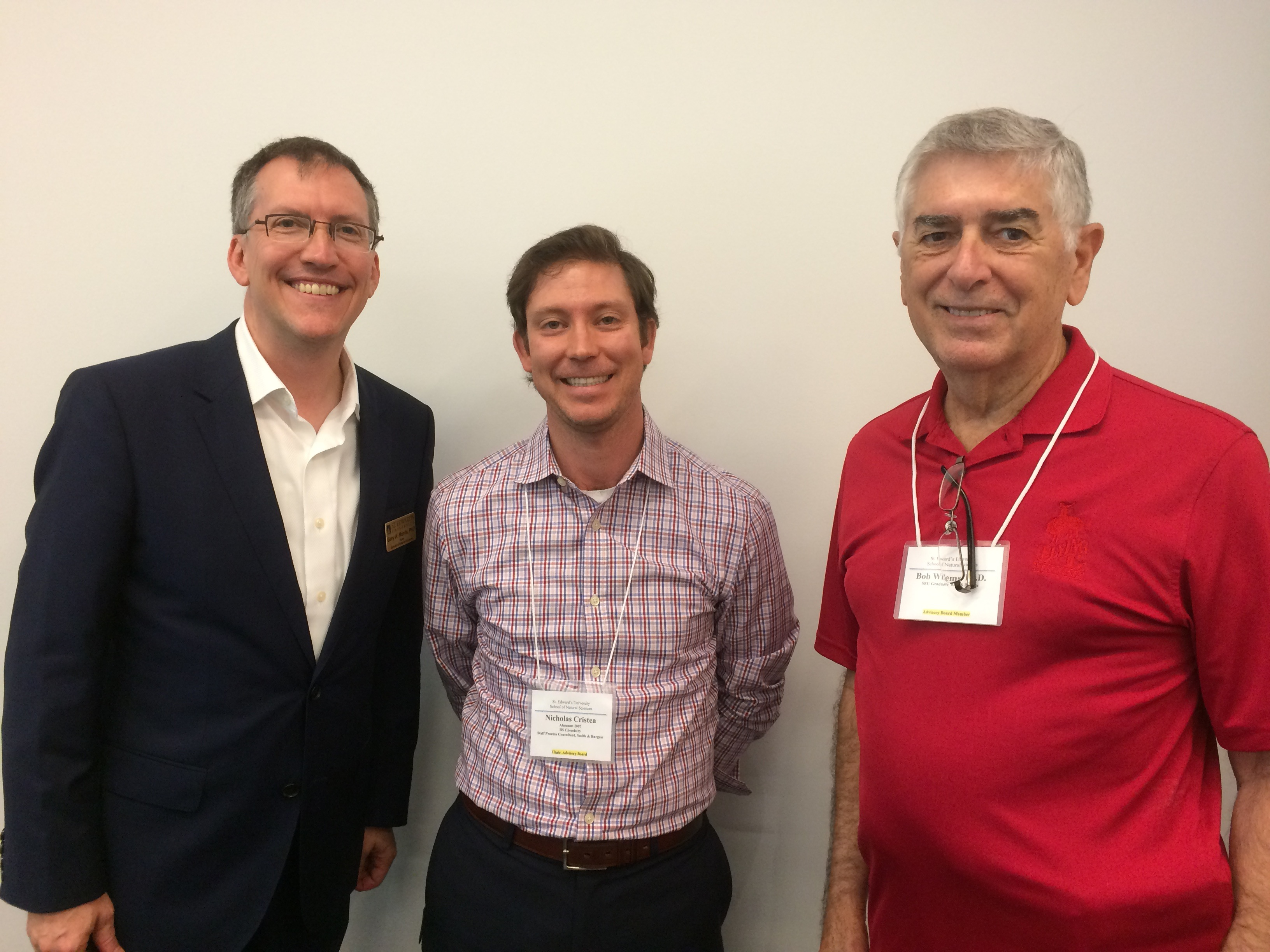 Bob Wilems (right) hands off leadership of the NSCI Advisory Board to Nick Cristea (center), with Dean Gary A. Morris (left).