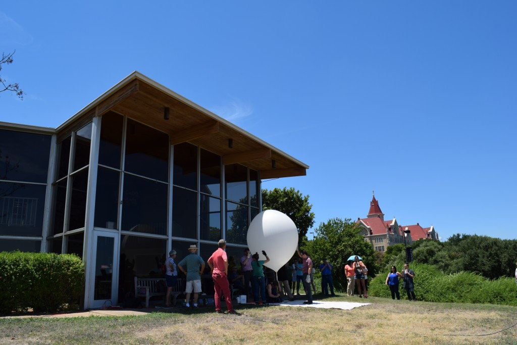 Weather balloon inflated with helium in front of the Mary Moody Northen Theatre at St. Edward's University prior to its release around 1:30 pm CDT on Thurs., 4 Aug. 2016.