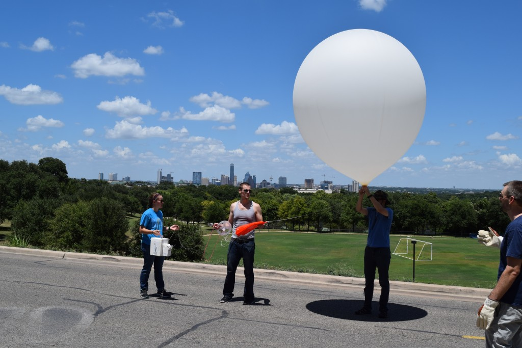 Preparing to release the balloon in front of Main Building with Austin in the background.