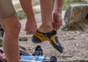 Climber changing into the propper shoes for outdoor climbing at