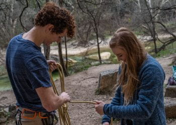 Partners untangle climbing rope before belaying eachother at the