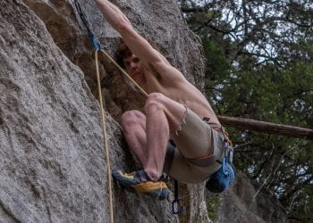 Climber grips holds as he plots next move at the Barton Creek Gr