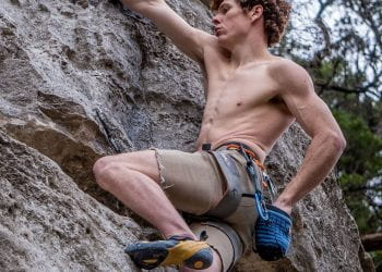 Climber reaches for chalk at the Barton Creek Greenbelt on 2/1