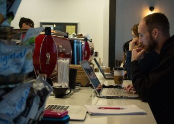 Customers Working at Coffee Bar