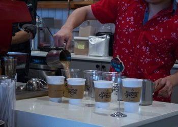 Barista Mixing Coffee with Moon Milk